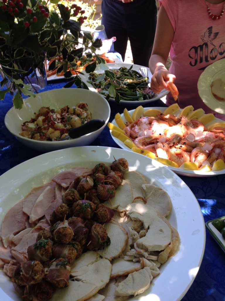 Gluten-free Christmas lunch meat, seafood and salads on platters