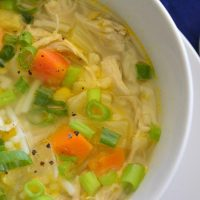 Bowl of gluten-free chicken vegetable soup with noodles